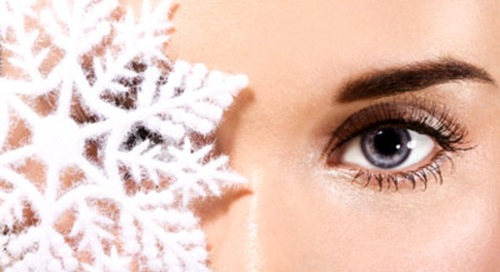Woman eye with snowflake closeup